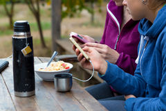 Rural vacation Scene Two People Breakfast and Gadgets Stock Photo