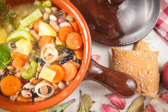 Rural vegetarian broth soup with colorful vegetables Stock Photos