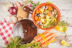Rural vegetarian broth soup with colorful vegetables Royalty Free Stock Photo