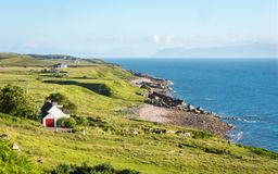 West coast of Scotland and The Isle of Skye. A rural view of the Scottish coastline on the northwest of the Highlands looking out towards the Isle of Skye on the Royalty Free Stock Image