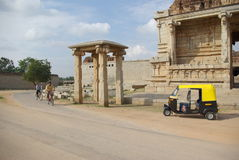 Rural view yellow rickshaw temple ruins, Hampi, Stock Photo