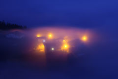 Rural village in Aramaio under fog at night Royalty Free Stock Images