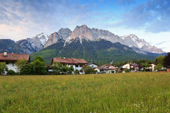 Rural village and Alpine Alps mountain Royalty Free Stock Photography