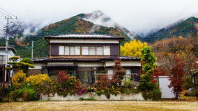 Rural village with fall color and mist Stock Images