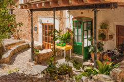 A rural village garden, Deia, Mallorca. A glimpse of the tranquil lifestyle in the garden of a traditional Mallorcan house in the beautiful village of Deia Stock Photo