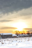 Rural village home in winter time at sunset Stock Photo