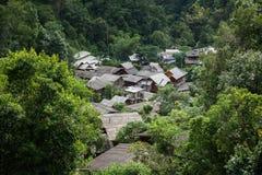 Rural village inside green forest Stock Photo