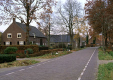 Rural Village in the Netherlands. A stretch of road in a rural village of the Netherlands in the autumn stock photography