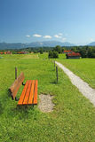 Rural walkway and bench, pictorial bavarian landscape.  Royalty Free Stock Photography