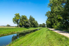 Rural water canal in forest Royalty Free Stock Photography