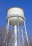 Rural Water Tower. Large water tower stands high in a rural community Stock Photo