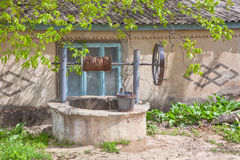 Rural water well near house stock image