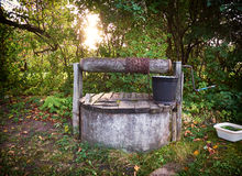 Rural well with bucket Stock Images