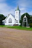 Rural White Church. Whitewashed Church Against a Blue Sky in a Rural Midwestern Town Stock Image