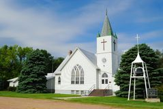 Rural White Church. Whitewashed Church Against a Blue Sky in a Rural Midwestern Town Stock Photography