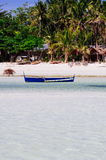 Rural white sand beach on tropical island Stock Image