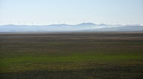 Rural wind farms at Lake George in Australia. View of huge wind turbines windmills. Lake George is an endorheic lake, as it has no outflow of water to rivers royalty free stock images