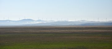 Rural wind farms at Lake George in Australia. View of huge wind turbines windmills. Lake George is an endorheic lake, as it has no outflow of water to rivers royalty free stock image