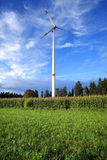 Rural wind turbine. To provide alternative electrical energy with minimal environmental impact Royalty Free Stock Image
