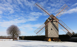 Rural winter landscape. Countryside landscape with traditional windmill during the winter, located in the central part of France Royalty Free Stock Images