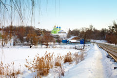 Rural winter landscape. With church on the hill stock image