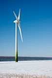Rural winter landscape with a big windturbine Royalty Free Stock Images