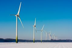 Rural winter landscape with big windturbines Stock Image