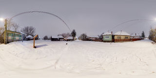 Rural winter landscape, Mikhaza, Romania. 360 panorama of a rural winter landscape with combined nighttime-daytime exposures in a snow-covered Mikháza Royalty Free Stock Images