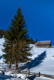 Rural winter landscape with old farm in the Carpathians Royalty Free Stock Image