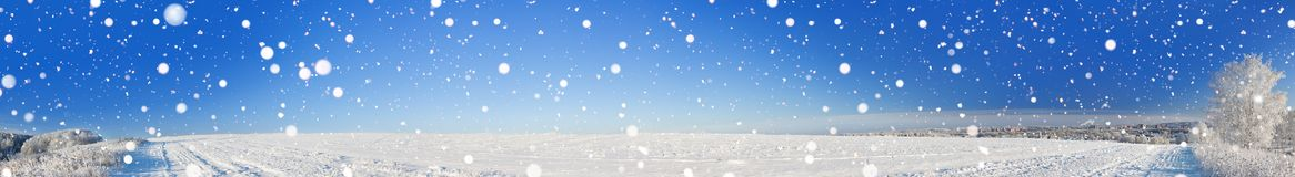 Rural winter landscape panorama with a field, snow, forest, city royalty free stock photos