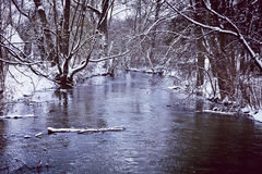 Rural winter landscape, river and snow Stock Photos