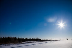 Rural Winter Landscape and Sunlight Royalty Free Stock Photo