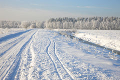 Rural winter road Stock Images