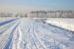 Rural winter road Stock Images