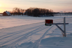 Rural winter sunset mailbox. Royalty Free Stock Images
