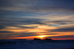 Rural winter sunset. Rural Minnesota sunset with farm buildings and fields Royalty Free Stock Photography