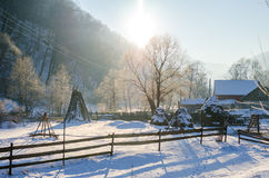 Rural winter view of a Romanian Village next to the woods with a wooden fence and a lot of snow Stock Photos