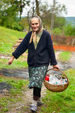 Rural woman with basket outdoor Royalty Free Stock Image