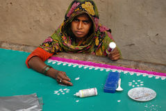 Rural Woman. A rural woman is doing stitching and embroidery to support their families in West Bengal-India. They earn a little money for fulfill their needs Royalty Free Stock Photo