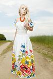 Rural woman standing by the field Stock Images
