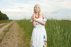 Rural woman standing by the wheat field Royalty Free Stock Image