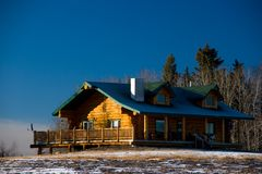 Rural Wood Home. A prairie home with a wooden exterior shot in early winter stock photography