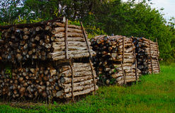 Rural Wood Log Stack. A day in the country you might find a field with stacked logs ready for fencing. Rough hewn and stacked neatly, these logs are drying in Royalty Free Stock Photos