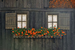 Rural wooden facade with windows and flowers in alps town Rhemes Notre Dame Royalty Free Stock Image