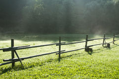 Rural wooden fence on meadow Royalty Free Stock Photography