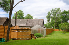Rural wooden fence separates the two courtyards Stock Photos