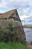 Rural wooden house. Rural countryside wooden house riverside Stock Photos