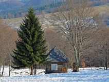 Rural wooden house in a mountain landscape Stock Photos