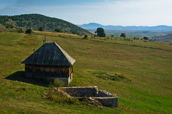 Rural wooden house at Pešter plateau panoramic landscape Stock Photos