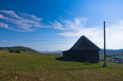 Rural wooden house at Pešter plateau panoramic landscape Stock Photo